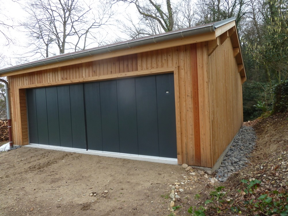 Construction d 39 un garage en ossature bois caluire for Construire garage en bois